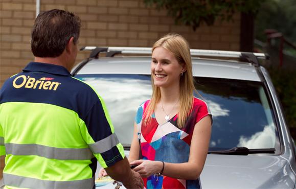 O'Brien® technician talking to a happy customer