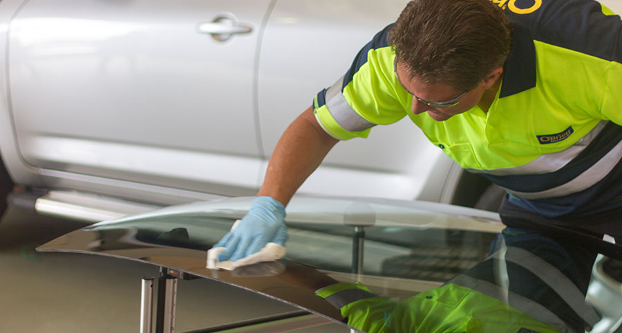 O'Brien® technician cleaning glass